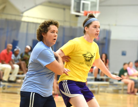 Sabrina Newman, left, is back on the basketball court this summer after treatment for breast cancer.