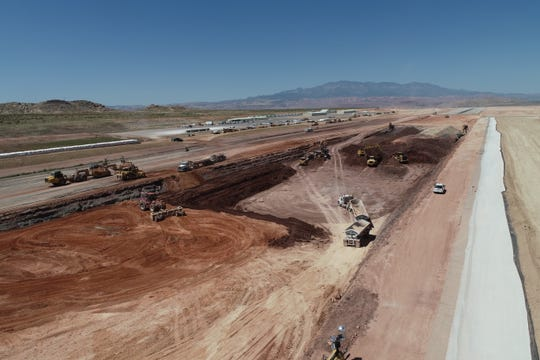 Construction crews continue work on the runway at the St. George Regional Airport Tuesday, July 9, 2019.