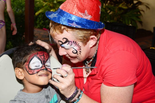 Noah Abijith is Spiderman thanks to Jenna Truxell of Faces by Jenna, who painted children's faces at Stars Over St. Lucie, Main Street Fort Pierce's Fourth of July celebration.