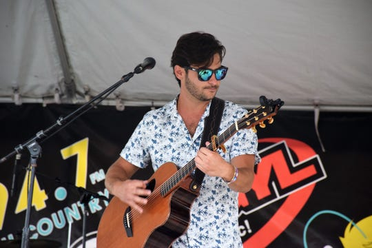 Country recording artist Kurt Stevens, a Vero Beach native now living in Nashville, performs on the Mid-Florida Stage at Vero Beach's Fourth of July celebration at Riverside Park.