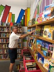 Volunteer Glenn Wells organizes the Children's Corner at the Friends' Book Depot in Stuart.