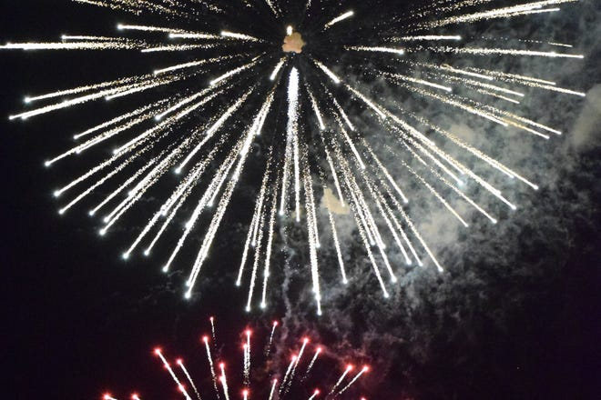 Fireworks light up the sky around Veterans Memorial Island Sanctuary in Vero Beach on the Fourth of July.