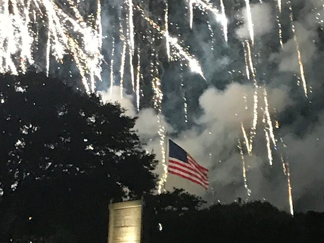 The weather was perfect for the Vero Beach Centennial Family, Fun, and Fireworks event at Riverside Park on the Fourth of July. Fireworks light up the sky and the U.S. flag flying on Veterans Memorial Island Sanctuary.