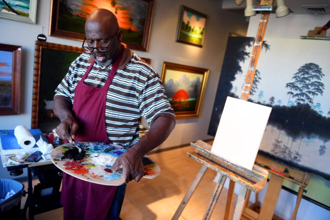 """Ray McLendon, a second-generation Florida Highwaymen artist, mixes paint to begin a new painting in his downtown Vero Beach art gallery. """"The canvas will show you what you're going to do,"""" he said. """"It's something you got to feel."""""""