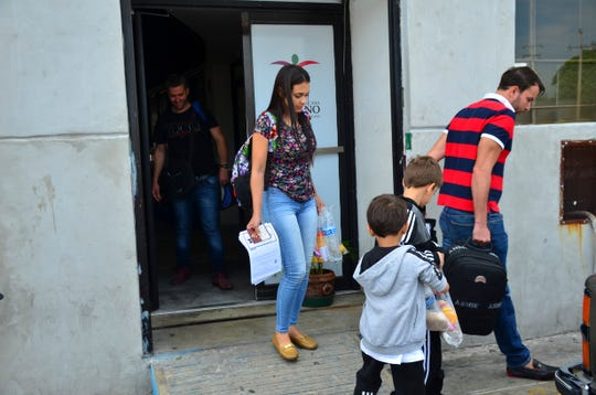 "Lucia Ascencio, of Venezuela, her husband and their two sons arrive back in Nuevo Laredo, Mexico, as part of the first group of migrants to be returned to Tamaulipas state under the so-called Remain in Mexico program for U.S. asylum seekers on Tuesday, July 9, 2019. ""We hadn't thought that they were going to send us back,"" said Lucia Ascencio. Her family was given a date in September to return for the next step in their process."