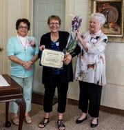 Pam McNamee (from left), awards chairperson, Millville Woman's Club, is joined by Barbara Westog, the club's Woman of the Year, and Pat Moore, club president, who is presenting Westog with a bouquet.