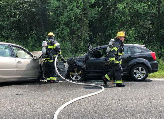 Vineland firefighters extinguish a car engine fire after a two-vehicle collision July 10, 2019 along East Wheat Road in Vineland.