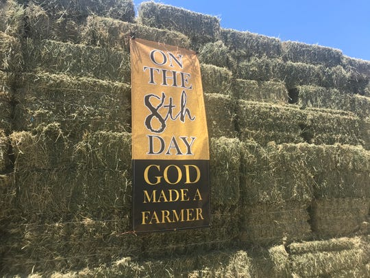 A sign extols the virtues of farmers at a rally on Wednesday, July 10 in Lemoore where Vice President Mike Pence appeared to campaign for the passage of United States-Mexico-Canada Agreement.