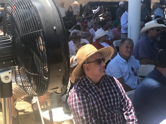 The crowd tries to stay cool while waiting for Vice President Mike Pence  spoke on Wednesday, July 10 in Lemoore where he campaigned for the passage of United States-Mexico-Canada Agreement.