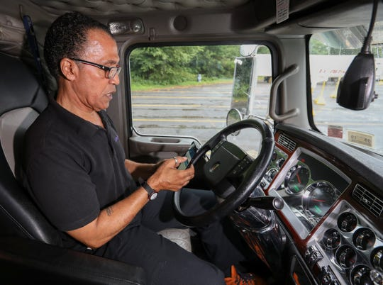 Long haul truck driver Jose Williams of Yorktown, works his electronic logging device in the cab of his truck, at a truck stop in  Montgomery on Monday, July 8, 2019.