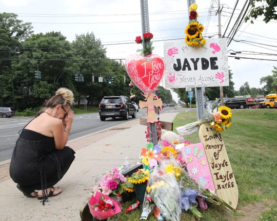 Lisa Bowers is overcome with emotion at a memorial for Jayde Taylor Marks, a woman killed Sunday by an allegedly drunken driver in front of Albertus Magnus High School in Bardonia. Photo taken July 10, 2019.