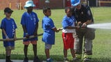 """At the second """"A Day in Their Boots"""" program at Dover Wednesday, hundreds of kids got to experience"""