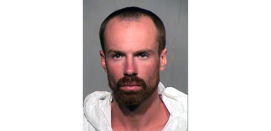 This undated booking photo provided by the Maricopa County Sheriff Office shows 27-year-old Michael Adams who has been arrested on suspicion of first-degree murder. Adams who was recently released from prison was arrested in the fatal stabbing of a 17-year-old boy found face down by fuel pumps at a metro Phoenix convenience store. (Maricopa County Sheriff Office via AP)