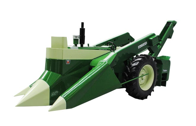 A 1600 Oliver with 74H mounted corn picker (1/16 die-cast model) is this toy collectible at this year's FTD show.