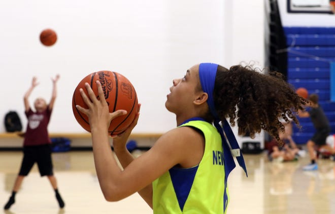 Rayne Newman readies a shot during the Kevin Martin Basketball Camp on Wednesday.