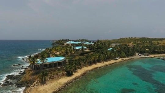 This Tuesday, July 9, 2019 video frame grab shows an aerial view of Little Saint James Island, in the U. S. Virgin Islands, a property purchased by Jeffery Epstein more than two decades ago. Epstein built on the island a stone mansion with cream-colored walls and a bright turquoise roof surrounded by several other structures including the maids' quarters and a massive, square-shaped white building on one end of the island.