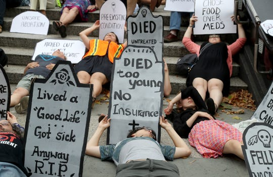 People participate in a health care rally in New York, New York, in July 2017.