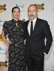 Annette Roque and Matt Lauer attend the 2013 Animal League America Celebrity gala at The Waldorf Astoria on Nov. 22, 2013 in New York City.