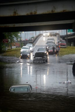 A car is under water as the intersection of Franklin Ave. and 610 floods after a severe thunderstorm Wednesday, July 10, 2019. A storm swamped streets in New Orleans and prompted a tornado warning near the city Wednesday as concerns grew that even worse weather is on the way to Louisiana and other states along the Gulf of Mexico.