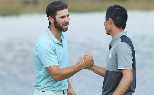 Matthew Wolff,  left, shakes hands with Collin Morikawa after the final round of the 3M Open.