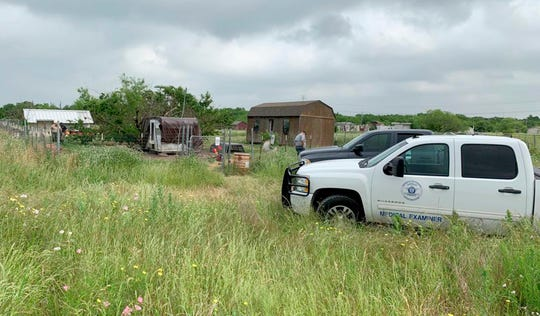 This May 20, 2019 photo provided by the Johnson County Sheriff's Office shows a medical examiners truck on the property of Freddie Mack's home in Venus, Texas. Authorities said Tuesday, July 9 thatthe 57-year-old Mack, who had been missing for months, was eaten, bones and all, by his dogs. Johnson County Sheriff Adam King says Mack had serious health problems and it's unclear whether his 18 dogs killed him or consumed his body after he died from a medical condition. A relative reported Mack missing in May.
