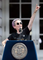 United States women's soccer team forward Megan Rapinoe (15) addresses the fans during the ceremony at City Hall after winning the 2019 FIFA World Cup.