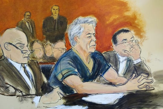 In this courtroom artist's sketch, Jeffrey Epstein (center) sits with attorneys Martin Weinberg, left, and Marc Fernich during his arraignment in New York federal court, July 8, 2019, on federal sex trafficking charges.