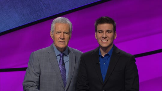 James Holzhauer, right, became a very familiar face to 'Jeopardy!' host Alex Trebek during his 32-game winning streak.