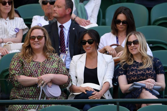 Meghan Markle, Duchess of Sussex watches Serena Williams play at Wimbledon last week, with her security behind her.