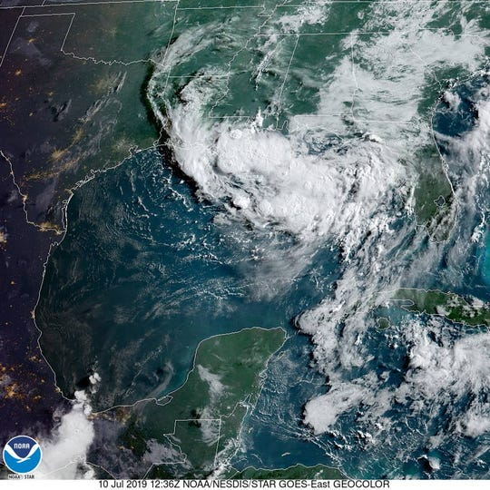 A tropical depression was slowly organizing over the northern Gulf of Mexico as seen in this satellite image July 10, 2019.