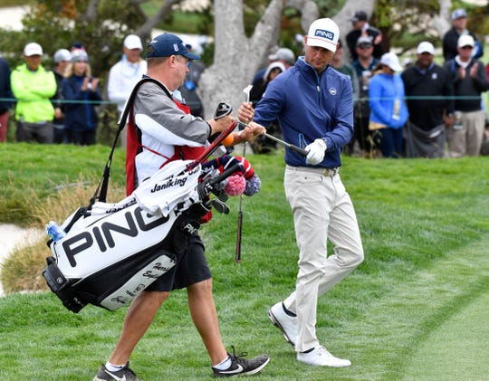 Harris English exchanges clubs with his caddie Eric Larson on the 5th hole during the third round of the 2019 U.S. Open at Pebble Beach Golf Links. (Michael Madrid-USA TODAY Sports)