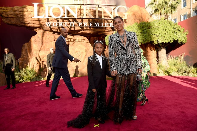 """Beyonce, right, and her daughter Blue Ivy Carter arrive at the world premiere of """"The Lion King"""" on Tuesday, July 9, 2019, at the Dolby Theatre in Los Angeles."""