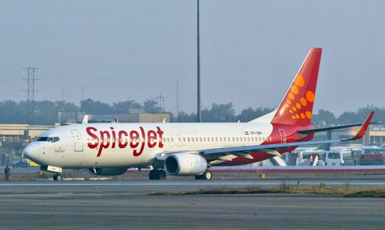 In this Friday, Jan 26, 2007 file photo, a SpiceJet aircraft taxies on the runway at the airport in New Delhi, India. A Spicejet technician was killed when the flaps covering an aircraft's main landing gear accidentally closed on him during maintenance work, an airline statement said on Wednesday, July 10, 2019.