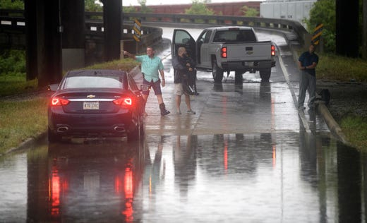 Motorists react as the intersection at Franklin Ave. and 610 in New Orleans floods after a severe thunderstorm Wednesday, July 10, 2019.