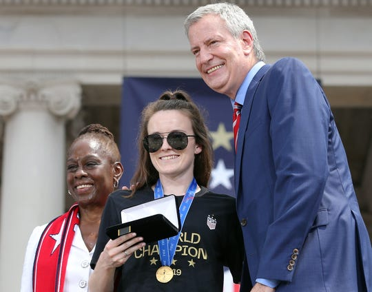 USWNT midfielder Rose Lavelle poses for a photo after receiving the key to the city from New York City mayor Bill de Blasio.