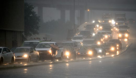 Traffic backs up as rain comes down at Airline Drive and S. Carrollton Ave. in New Orleans, as severe thunderstorms cause street flooding Wednesday, July 10, 2019.