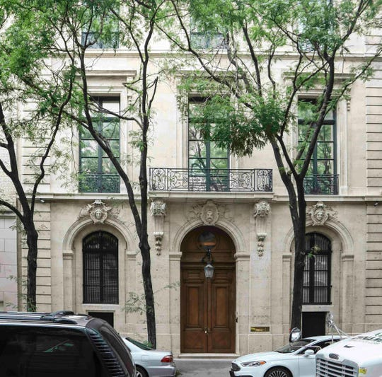 "This photo shows the Manhattan residence of Jeffrey Epstein, Monday July 8, 2019, in New York. Prosecutors said Monday, federal agents investigating wealthy sex offender Jeffrey Epstein found ""nude photographs of what appeared to be underage girls"" while searching his Manhattan mansion."
