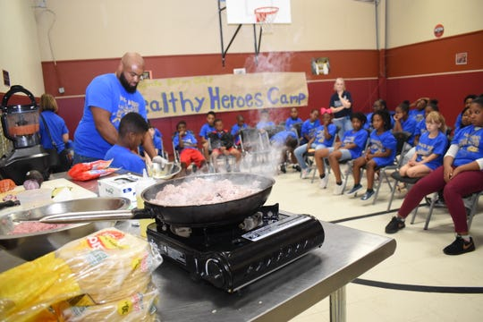 John Belvin Jr., executive chef at the Diamond Grill was the guest speaker at the Healthy Heroes Camp sponsored and coordinated by the Pineville Rotary Club and the Pineville Youth Center. He taught the campers how to make turkey tacos, homemade salsa and homemade guacamole. Dorian Hinkston, 6, was Belvin's helper. Dorian wants to be a chef when he grows up.