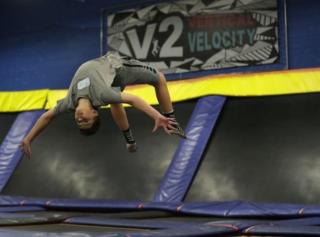 Zane Harper, 15, of Oshkosh does a  back flip at Vertical Velocity in Buchanan/Darboy.