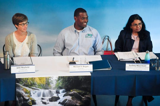 From left, Julie Mayfield, Co-Director of MountainTrue, Michael Regan, Secretary of the N.C. Department of Environmental Quality in Raleigh, and Sushma Masemore, Assistant Secretary of DEQ, sit in on an environmental roundtable at The Wedge July 10, 2019.