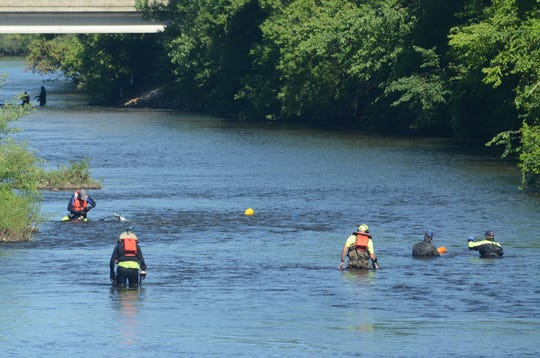 Divers from Kalamazoo and Berrien counties search for evidence in Thursday's training exercise.