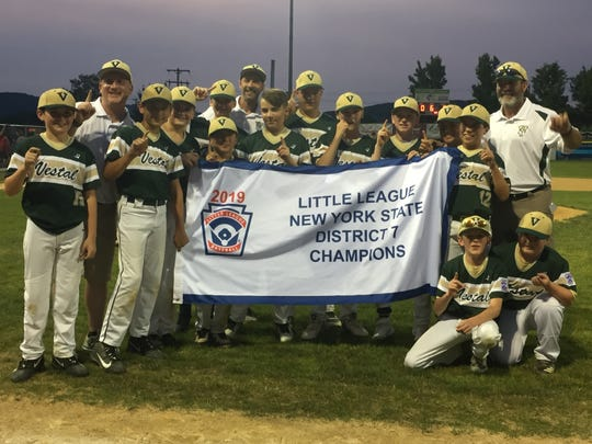 Vestal players and coaches celebrate after their 6-0 victory over visiting Endicott on Monday in the District 7 Little League final. Vestal will play Baldwinsville on Saturday in the Section 1 East Tournament at Cortland.