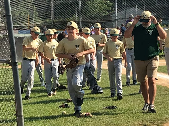 Vestal players and coach Derek Washburn head to the dugout before Wednesday's game against Ithaca at Owego. Vestal will play Baldwinsville at 2 p.m. Saturday in a Section 1 East tournament opener.