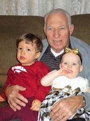 Bill Sullivan, of Binghamton, with his two great-grandchildren.