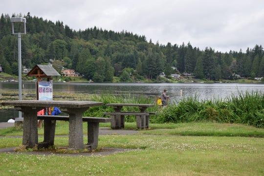 Picnic tables at Kitsap Lake park.