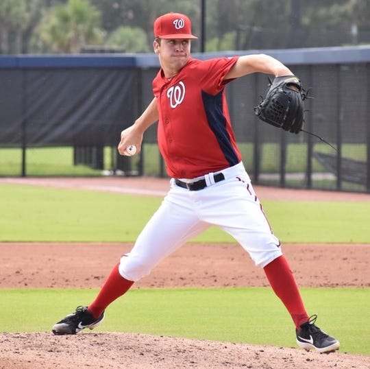 Former Merritt Island High star Mason Denaburg pitches for the Gulf Coast Nationals in West Palm Beach.