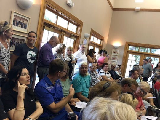 Indialantic residents packed Town Hall for a Town Council vote on whether to change drive-thru restrictions to allow a new Starbucks to open. The council approved the ordinance on July 10, 2019 and a second hearing is required.