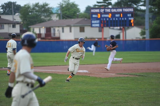 Austin Harper rounds third heading home to score for the Galion Graders.