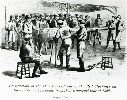 An illustration of the presentation of the championship bat to the Cincinnati Red Stockings when they returned from a victorious five-week road trip in 1869.