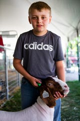 Jeremy Makstaller, 12, poses for a portrait with his goat Ace on Wednesday, July 10, 2019, at the Hamilton County 4-H Community Fair in Crosby Township, Ohio.